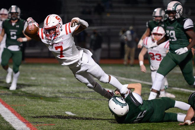 Running back Jalen White dives into the end zone for Souderton's first touchdown during the District One Class 6A title game against Pennridge on Friday.