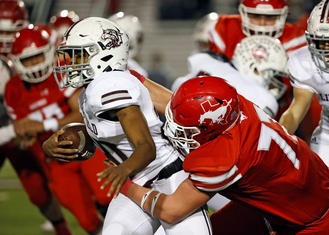 Denver City's Carson Little (77) tackles Littlefield's Tyjae Chambers (20) during a Class 3A Division I game Friday, Nov. 13, 2020, at Pirate Stadium at First United Park in Woodrow, Texas.