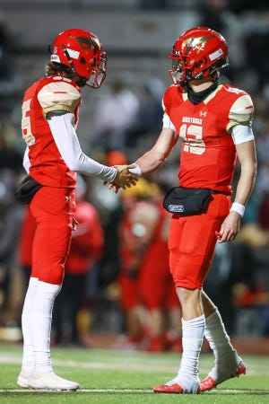 Coronado's Devin Samples (35) and Sawyer Robertson (12) high-five after a touchdown during a District 2-5A Division I game Nov. 13, 2020, against Amarillo High at PlainsCapital Park at Lowrey Field.