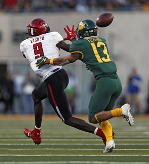 Texas Tech wide receiver T.J. Vasher (9) catches a pass in front of Baylor cornerback Raleigh Texada during the Bears' 33-30 double-overtime victory last year in Waco. Vasher has 16 receptions and two touchdowns in his career against the Bears.