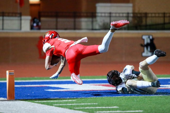 Coronado's Cory Ferriera (3) falls into the end zone for a touchdown during a District 2-5A Division I game Friday, Nov. 13, 2020, against Amarillo High at PlainsCapital Park at Lowrey Field in Lubbock, Texas.