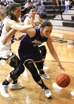 Anacoco's Bailey Davis (with ball) drives to the basket in the Lady Indians' win over Florien on Friday. Davis scored 18 points in the 58-50 victory.