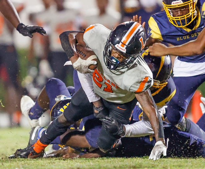 Lakeland running back Reggie Kellum dives for a first down against Winter Haven during a Class 7A, Region 3 play-in game at Denison Stadium.