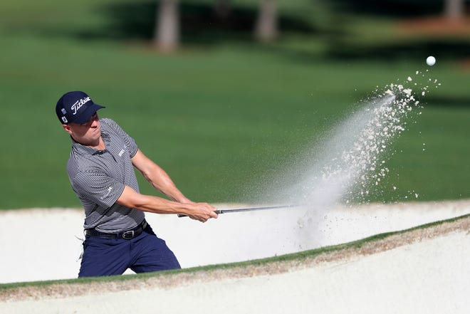 Justin Thomas hits out of the bunker on the 7th green during the second round of the Masters tournament Friday in Augusta, Ga.