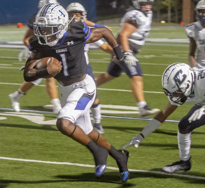 Lakeland Christian School running back Cori Davis (1) rushes for the team's first touchdown against Calvary Christian School during the first quarter of their Class 3A quarterfinal playoff game at Viking Stadium on Friday night.