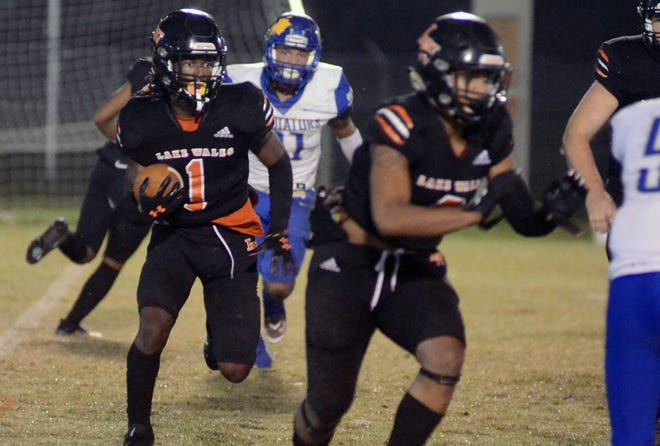 Lake Wales  running back Merari McCullough looks to make a move against St. Pete Gibbs in a Class 5A, Region 3 playoff game on Friday at Legion Field in Lake Wales.