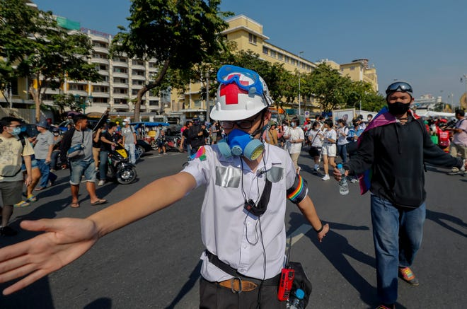 A high school student, with duct tape concealing ID tags on his school uniform,  marches in front lines during a street protest close to the Democracy Monument in Bangkok, Thailand, on Saturday.