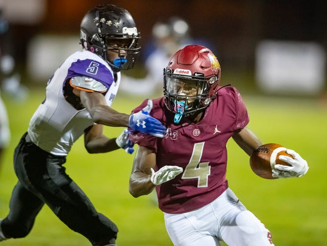 Lake Gibson's Chris Moore (4) eludes the tackle by a Spoto defender during the first quarter at Lake Gibson in Lakeland on Friday.