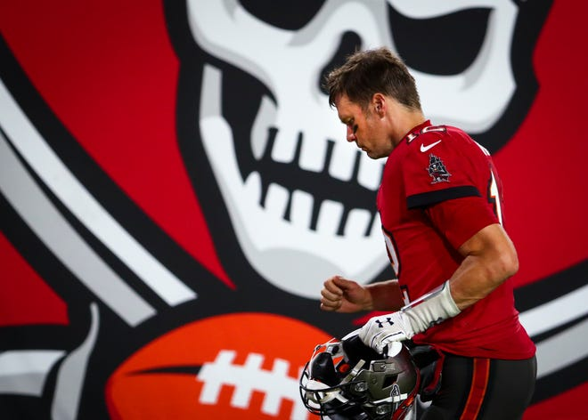 Tampa Bay Buccaneers quarterback Tom Brady jogs to the locker room after losing to the New Orleans Saints 38-3 in Tampa last Sunday.