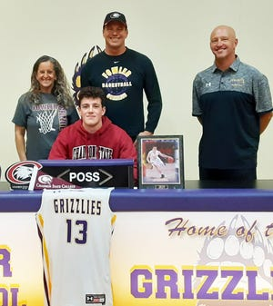 Fowler High School's Val Leone (front) signed a national letter of intent to play basketball at Chadron State (Neb.) College. Also pictured, back row from left, are Trish Leone, Val's mother, Rick Leone, his father, and Fowler head boys basketball coach Mark Lowther.