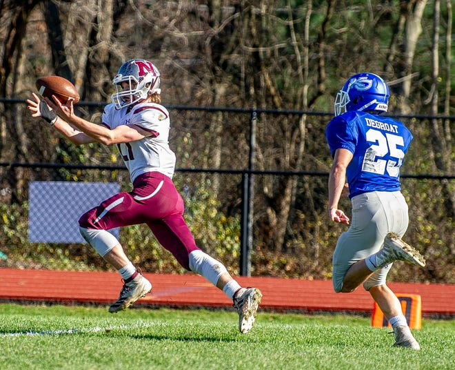 Newton's Aaron Fantasia, left, reels in a touchdown pass ahead of Kittatinny defender Davin DeGroat during the teams' game on Nov. 14 at Kittatinny High School in Hampton.  (Photo by Warren Westura for the New Jersey Herald)