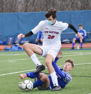 New Hartford's Colton Suriano tries to avoid Whitesboro's Max Pawlowski as he attempts to make a tackle during the Tri-Valley League Colonial Division championship game on Saturday afternoon at Ed Wadas Athletic Complex in Marcy. New Hartford won 1-0.