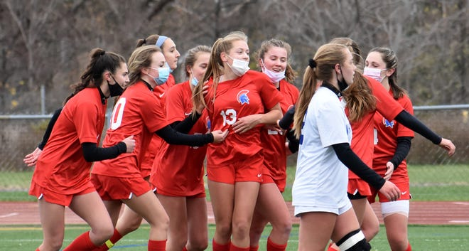 New Hartford's Willa Pratt (13) is serenaded with cheers and hugs from her teammates after scoring a goal in the first half of the TVL Colonial girls soccer championship game Saturday at Don Edick Field in New Hartford. The Spartans beat Whitesboro 3-1.