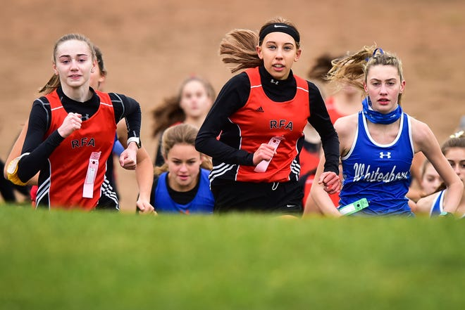 From left, Marlo Townsend, Emily Toth-Ratazzi and Caleigh McQueeney lead the pack during the start of the Tri-Valley League Large School championship meet Saturday at Ralph Perry Junior High School in New Hartford.
