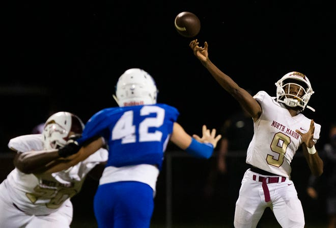 North Marion's Quintin Gross makes a pass in the first half. The Colts defeated the Rattlers 47-0 Friday night.