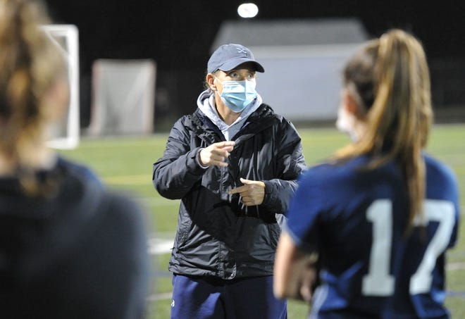 Cohasset girls varsity coach Deb Beal instructs her team during their match with Hull at Cohasset High School, Friday, Nov. 13, 2020.