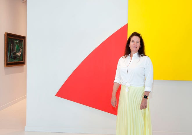 "Gallery owner Eleanor Acquavella poses in front of Ellsworth Kelly's 1989 piece ""Untitled (Red and Yellow)."""