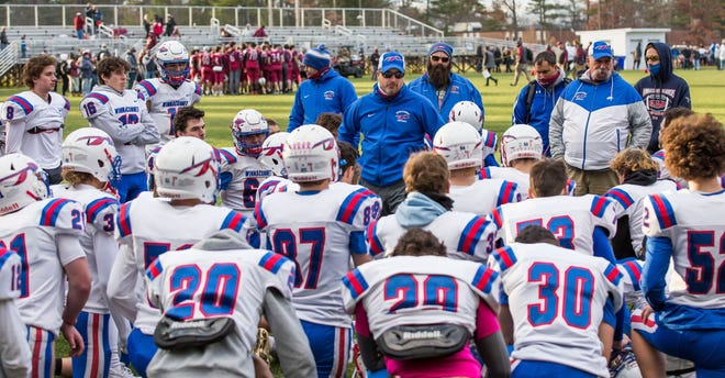 Winnacunnet High School football coach Ryan Francoeur (center) talks to his team following Saturday's 27-15 loss to Goffstown in a Division I semifinal.