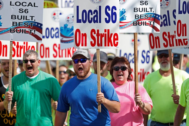 In this July 25, 2020, photo striking Bath Iron Works shipbuilders march in solidarity, in Bath, Maine. After a bitter two-month strike during a pandemic, BIW and its production workers are catching up on the production schedule.