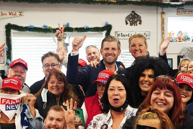 Patrons at Ryan's Place restaurant in Epping pose for a group photo with President Trump's son Eric Trump during a campaign stop Oct. 19.