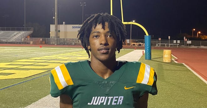 Jupiter's Emonte Brown poses for a photo after his three-touchdown performance in a 35-28 win over Palm Beach Gardens on Friday, Nov. 13, 2020.