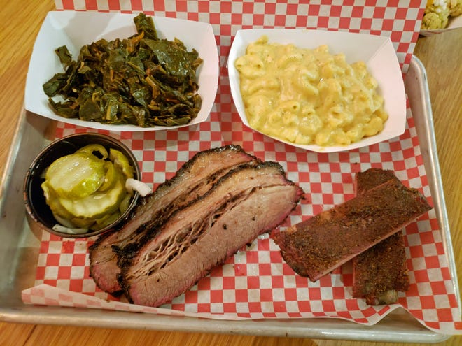 A sampler of faves at Durk's, including ribs, brisket, pickles, collard greens and mac and cheese.