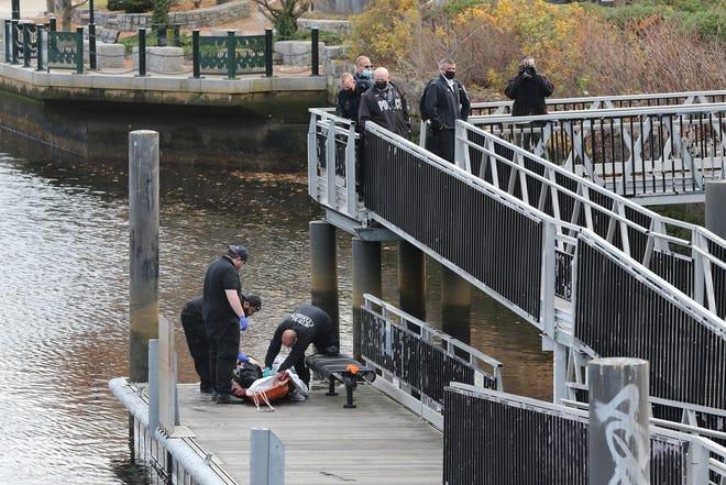 A body is removed from the Providence River at Dyer Street Landing on Saturday before being transported to the state medical examiner's office.