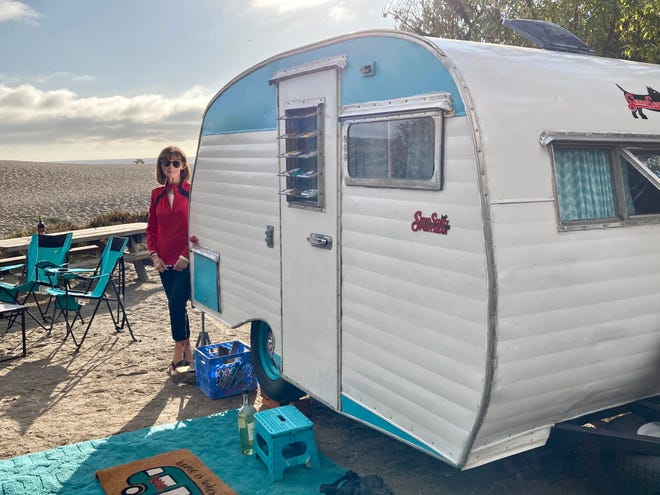 Our Scotty trailer, and spouse Susan, at Wright's Beach just north of Bodega Bay.