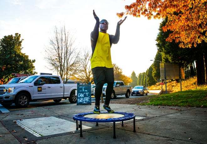 Troy Monroe puts on a dance show for passing motorists on the corner of Coburg Road near the Ferry Street Bridge in Eugene.
