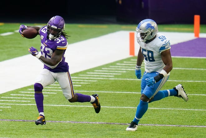 Minnesota Vikings running back Dalvin Cook (33) runs past Detroit Lions linebacker Reggie Ragland during the second half of their Nov. 8 game in Minneapolis. Cook leads the Vikings against the Chicago Bears on Monday night.