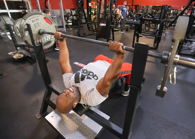 J-Vonne Humphreys works out at Powerhouse Gym in Jackson Township on Saturday afternoon. Owner Chris Maggiore said a shutdown of gyms as a result of the increase in COVID cases this month isn't justified.