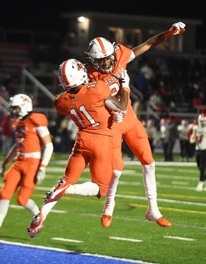 Massillon receiver Andrew Wilson - Lamp, right, celebrates fellow receiver Martavien Johnson's game winning touchdown with him in the end of the fourth quarter against Cincinnatti La Salle.