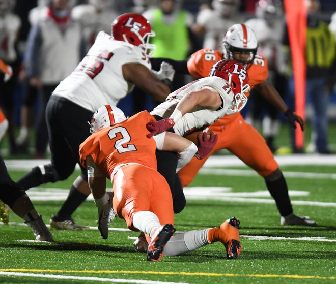 Massillon's Caiden Woullard tackles Cincinnati La Salle's Jack Rutz during the teams' Division II state semifinal game last Friday.  (IndeOnline.com / Kevin Whitlock)