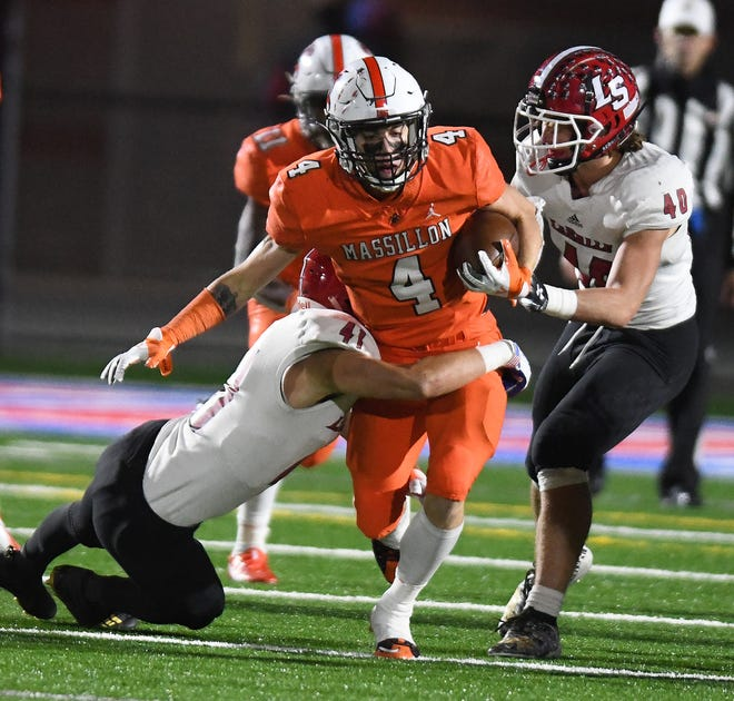 Massillon receiver Austin Brawley fights for yardage in the second half with pressure from LaSalle defenders Tristan Wolf,  left, and JD Wallace.