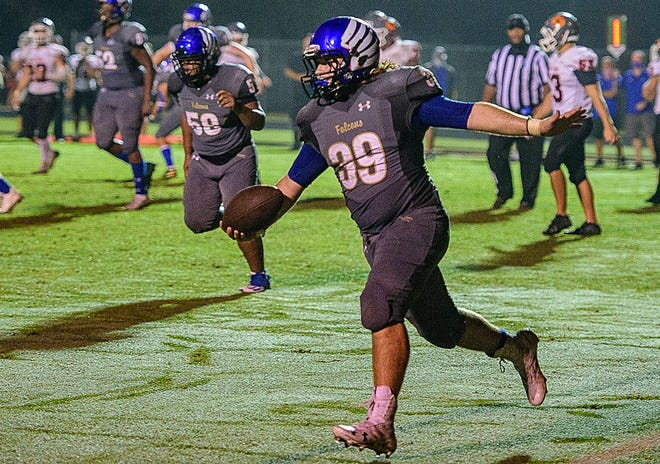 Pedro Menendez High School's Zander Martin scores a touchdown from 2 yards out with 37 seconds left to play in the fourth quarter in Friday's game against Mount Dora.