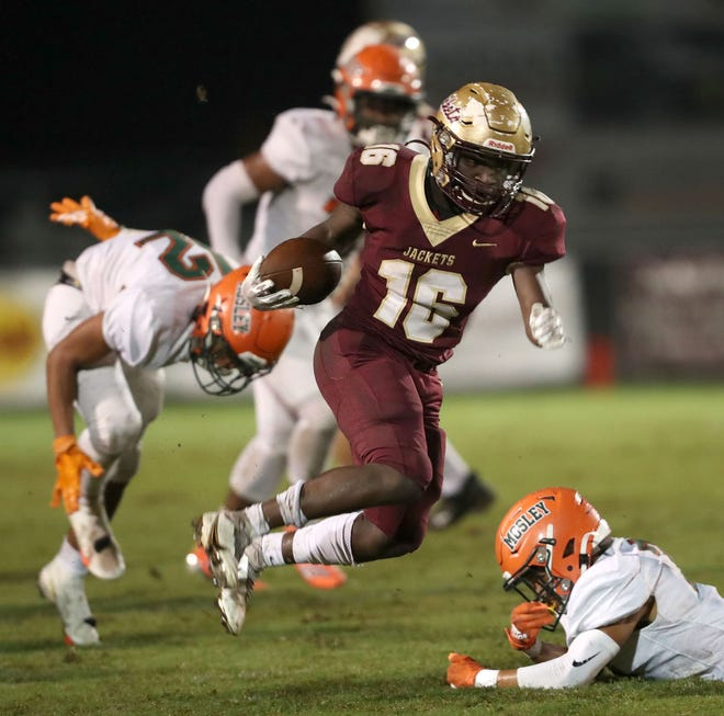 St. Augustine running back Ty Baxter makes a defender miss a tackle during a second quarter run against Lynn Haven Mosley Friday in St Augustine.