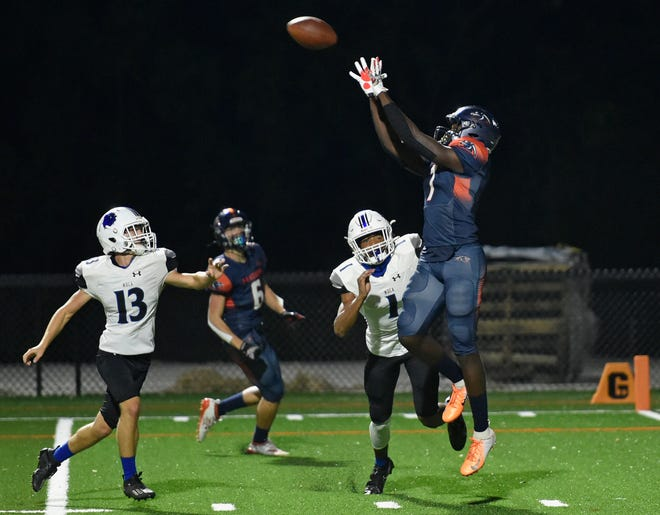 Bradenton Christian's E.J. Williams (7) scores a touchdown on a Zander Smith (15) pass in the first quarter against the Mount Dora Christian  during a SSAC playoff game at Bradenton Christian's football stadium Friday night.