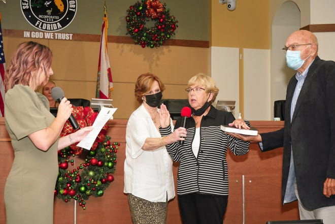 North Port District 2 City Commissioner Barbara Langdon, third from left, recites the oath of office Saturday morning. Pictured along with Langdon, from left: City Clerk Heather Taylor; Kathy Garrity and Langdon's husband Tom Munroe.