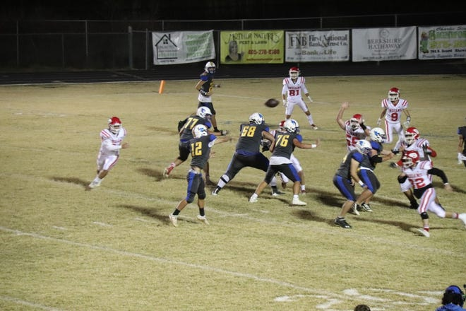 Bethel's Jesse Tucker (12) delivers a pass Friday night against Comanche in the opening round of the Class 2A playoffs.