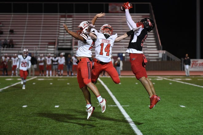 Plainview's Morgan Pearson (10) makes a catch near two McLoud defenders, including Karson Cue (14) Friday night in Plainview in the first round of the Class 3A playoffs.