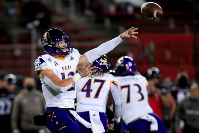 East Carolina quarterback Holton Ahlers throws a pass during the first half of Friday's American Athletic Conference contest at Cincinnati. (AP Photo/Aaron Doster)