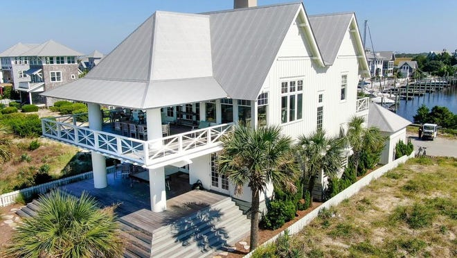 This home at 202 Row Boat Row in Bald Head Island is on the market for $3.3 million. The Wilmington area set a record in 2020 for both the number of luxury homes sold and the amount of money those homes sold for. [REALTOR.COM]
