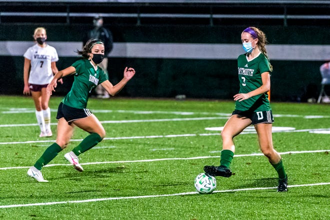 Kyleigh Wheaton lays the ball off for the cutting Kelly Medeiros.  [RYAN FEENEY/STANDARD-TIMES SPECIAL/SCMG]