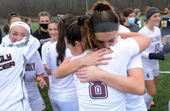 Killingly's Sophia Moore, left, and Abbie Burgess hug after their 2-1 Region III Final victory over Woodstock Academy Friday in Woodstock. See more photos at NorwichBulletin.com