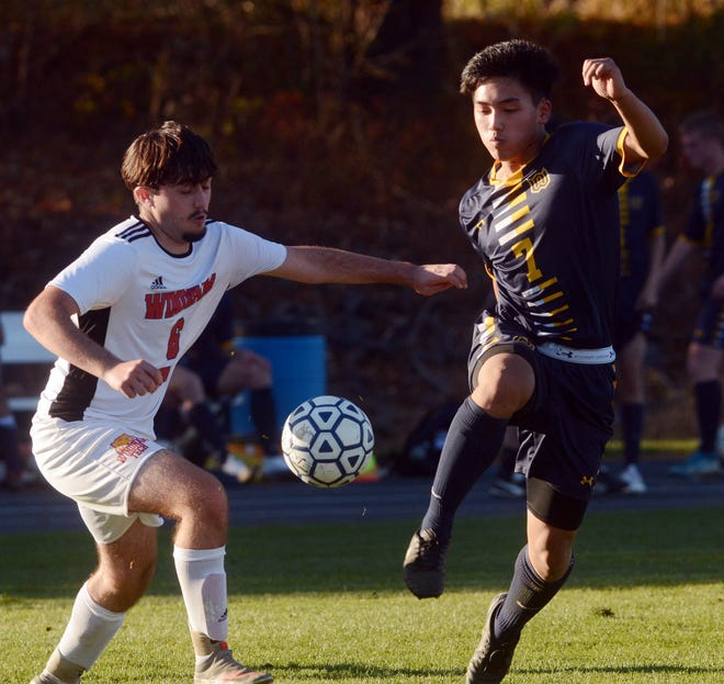 Woodstock Academy's Eric Phongsa and Windham Tech's Rease Courtois battle for the ball during a match earlier this season in Woodstock.