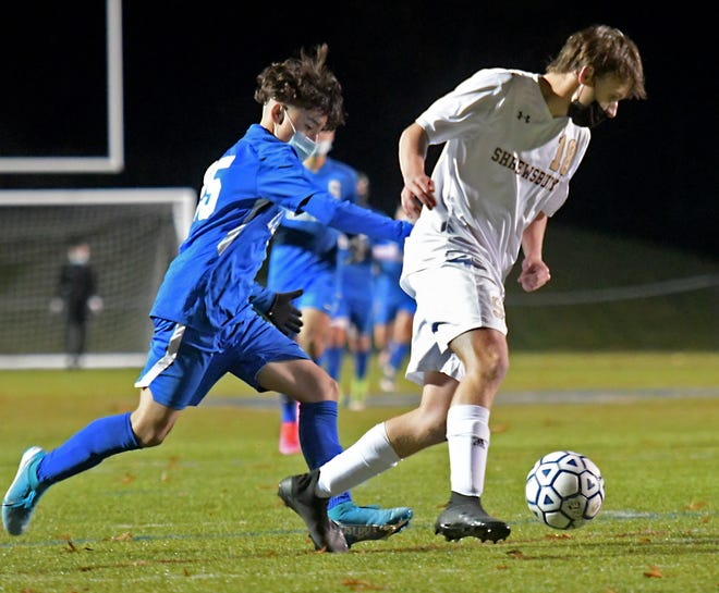 Shrewsbury's Max Lorentsson, right, breaks away from Leominster defender John Lima during last month's POD 8 Championship game.