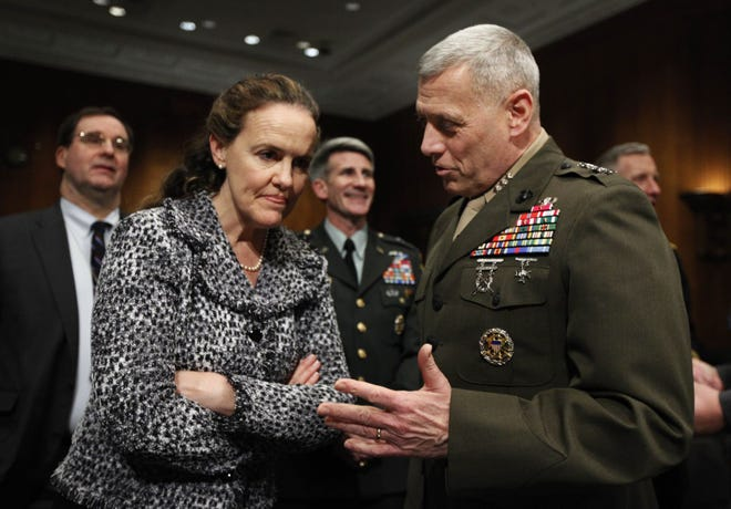 In this 2010 file photo then-Defense Undersecretary for Policy Michele Flournoy, left, talks with Marine Lt. Gen. John Paxton, director for operations, the Joint Staff, talk on Capitol Hill in Washington.