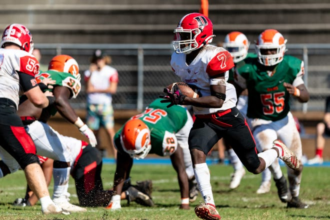 Dunnellon wide receiver Demetrius Mccants runs with the ball Saturday against Eastside in the FHSAA Football State Championships 5A Playoff at Citizens Field in Gainesville.