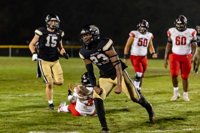 Buchholz linebacker Gavin Hill (23) celebrates after a sack against Creekside in the Class 7A playoffs.
