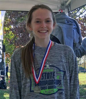 Glencoe sophomore Katie Giles was all smiles after winning the Class 3A girls individual state championship in cross country Saturday, Nov. 14, 2020, at Oakville Indian Mounds Park in Moulton.
